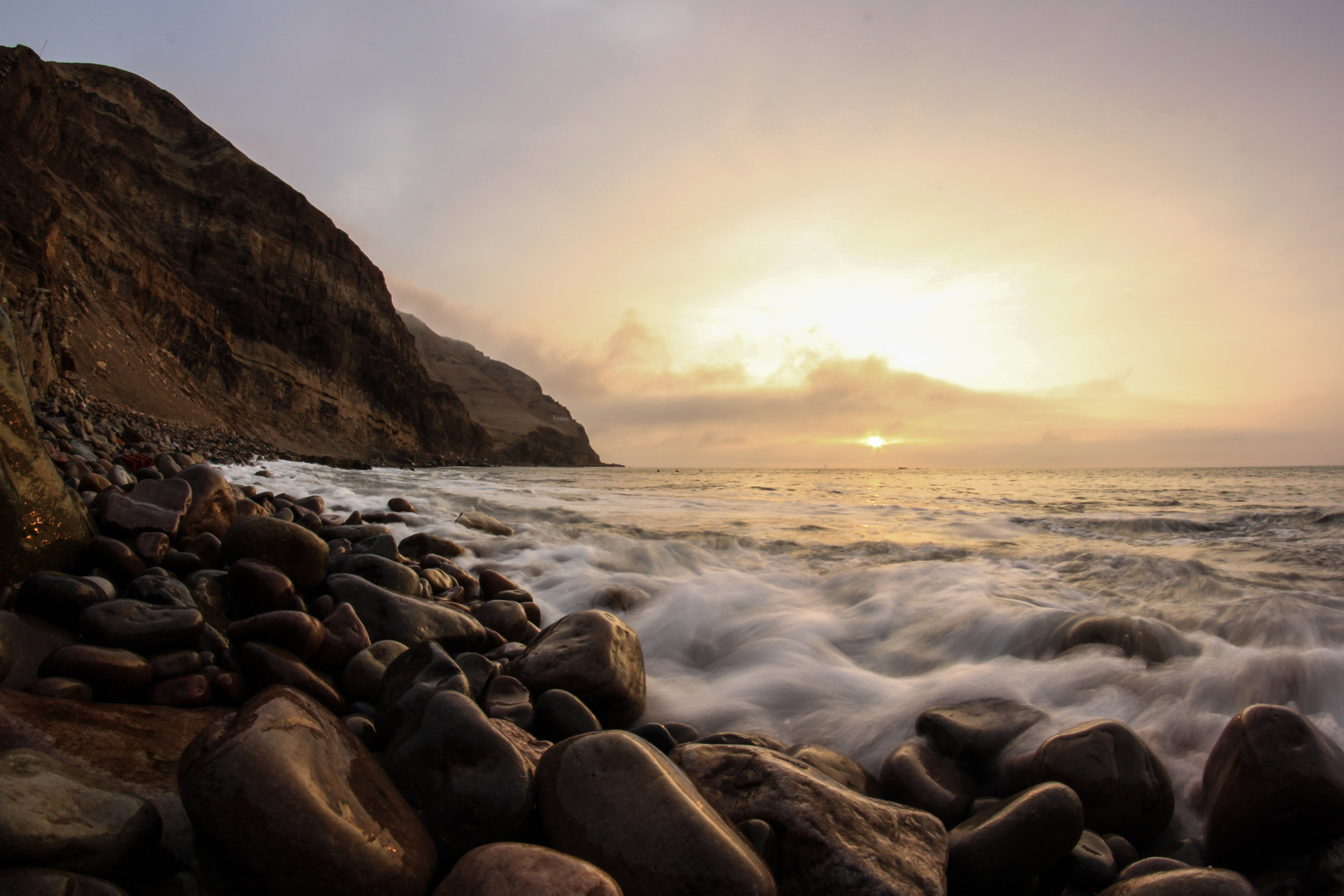 An artistic low level shot of La Herradura beach in Chorillos, Lima at sunset.