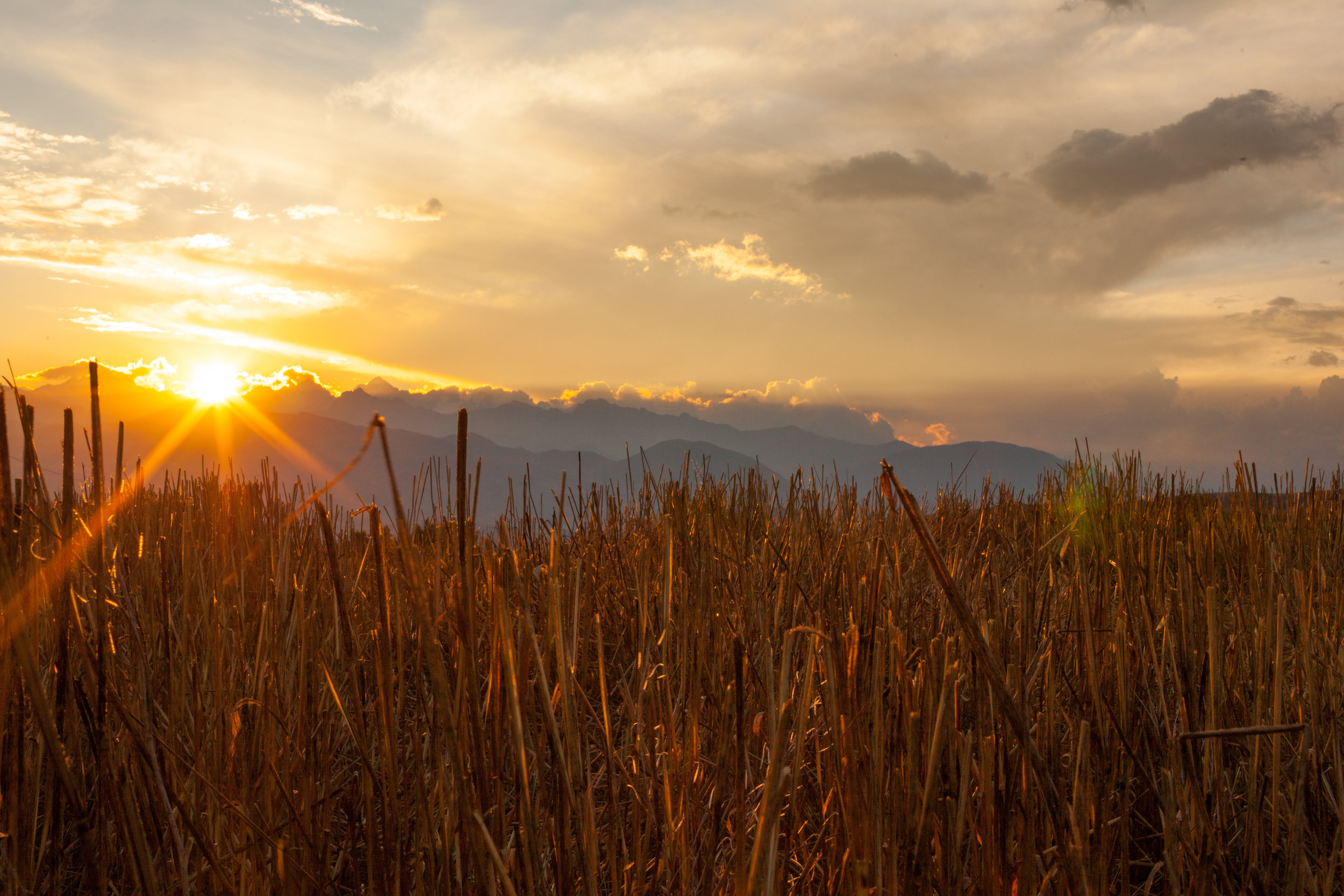 The sun sets across a farmers field in the sacred valley in Peru, South America.