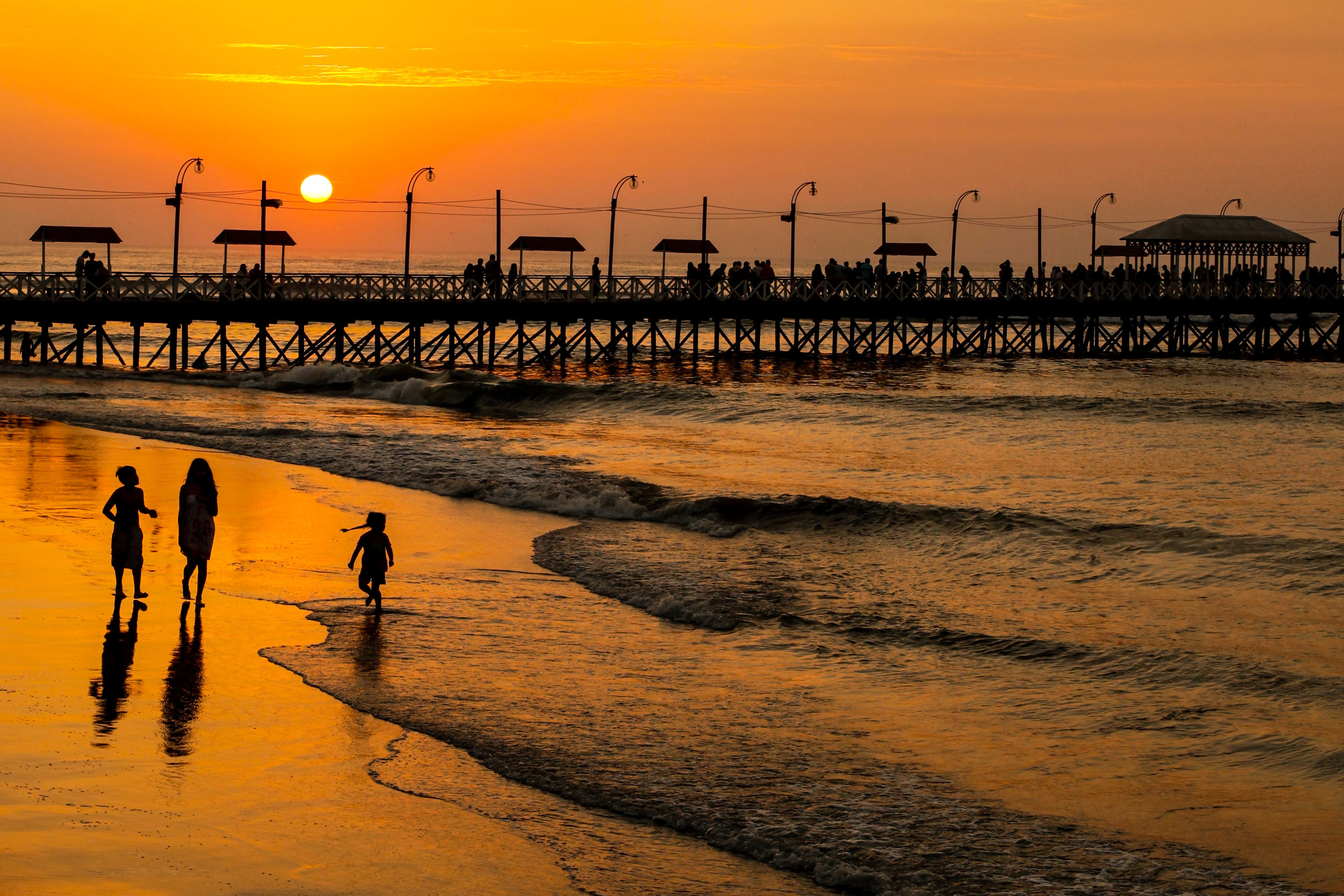 Golden sunset over the pier in Huanchaco, Trujillo, Peru.