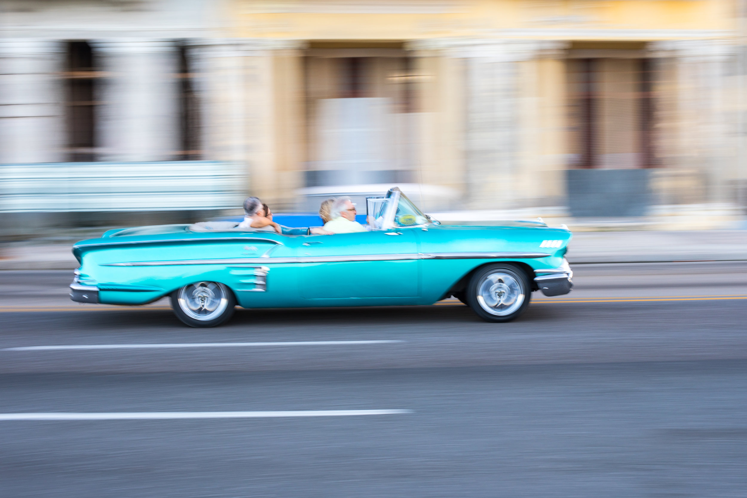 A classic car drives past in La Habana, the capital of Cuba.