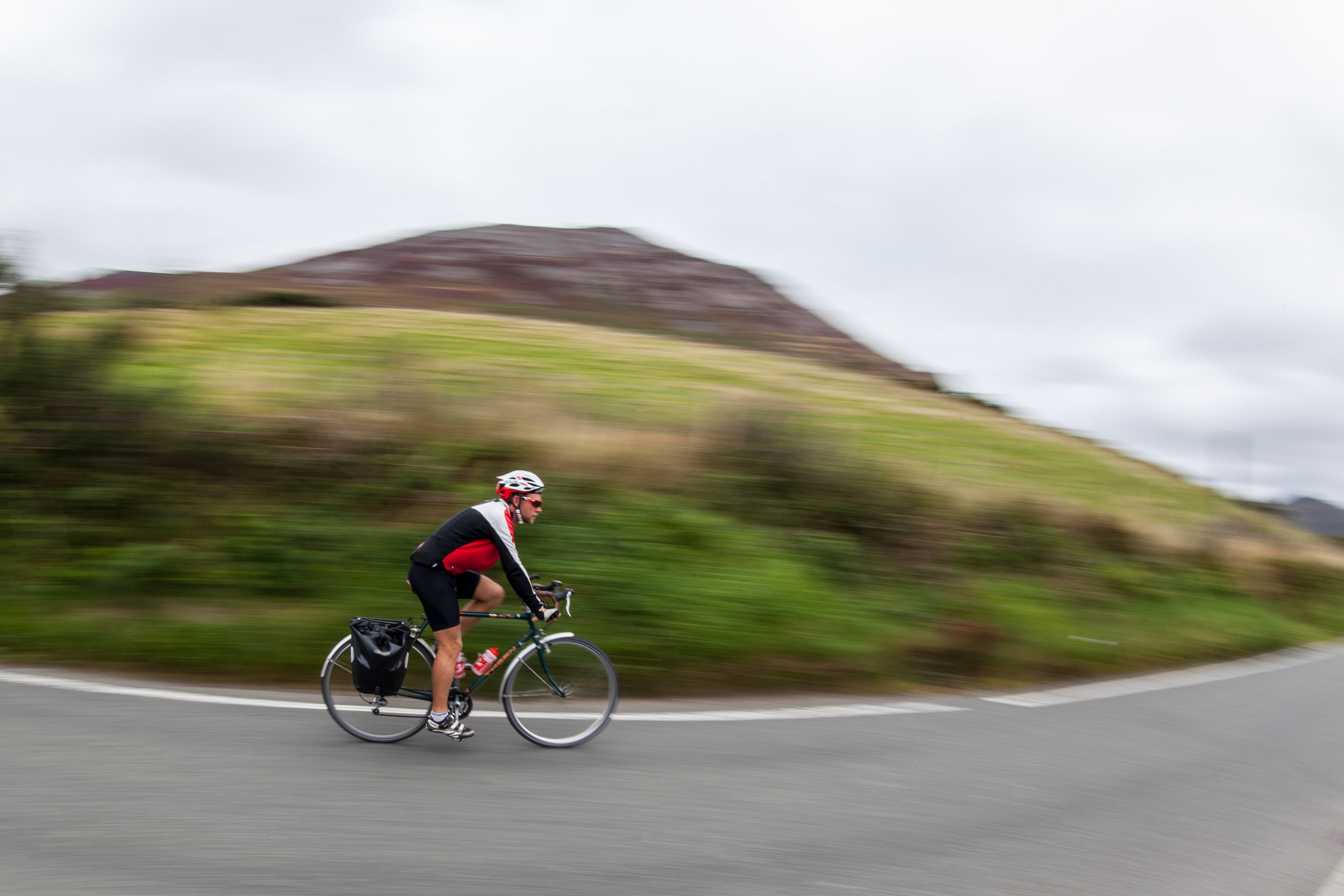 James Cope speeds by on his bicycle in North Wales on the Countrywide Great Tour.
