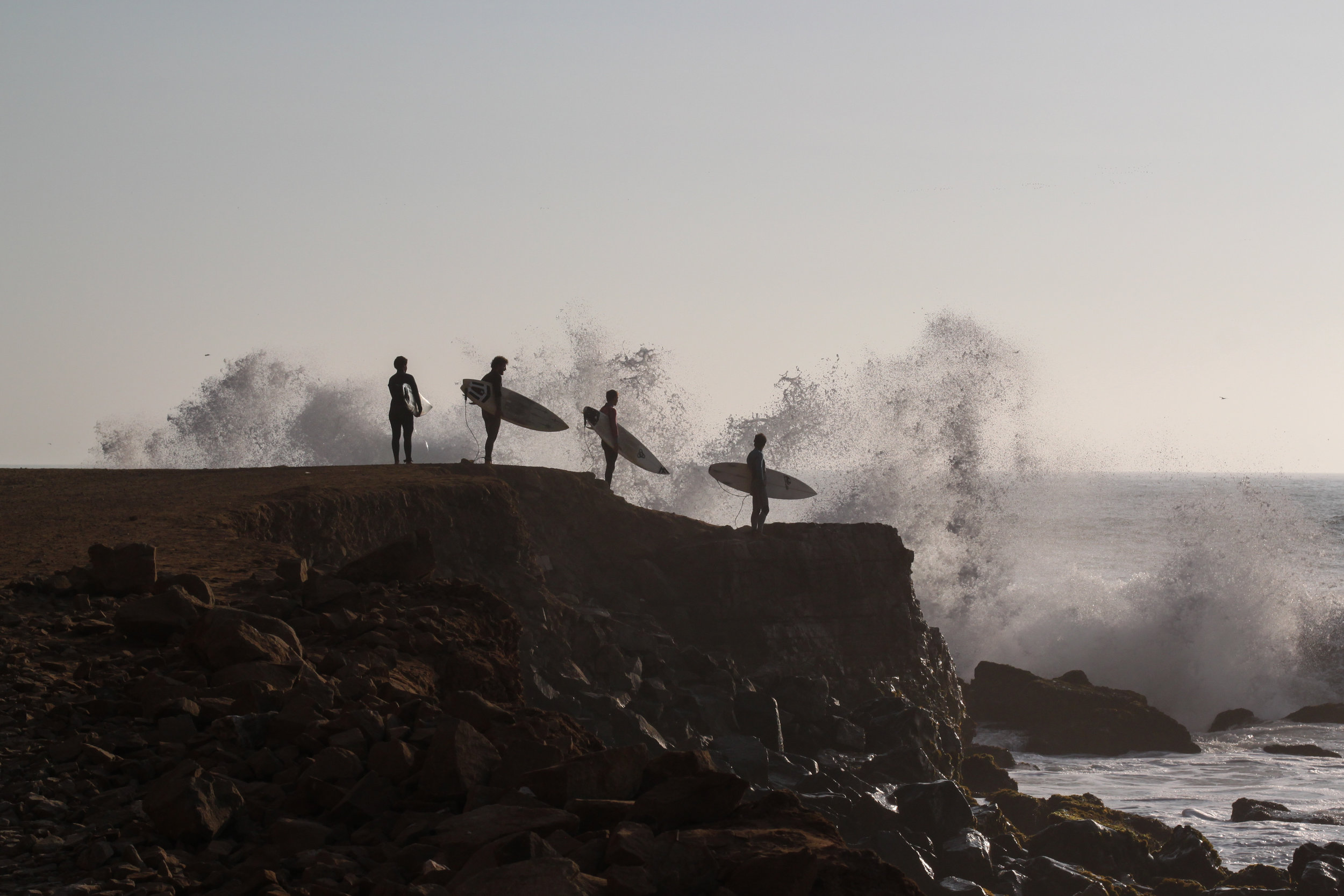 Surfers wait to enter the ocean during a bis swell at La Herraudra, Lima, Peru.