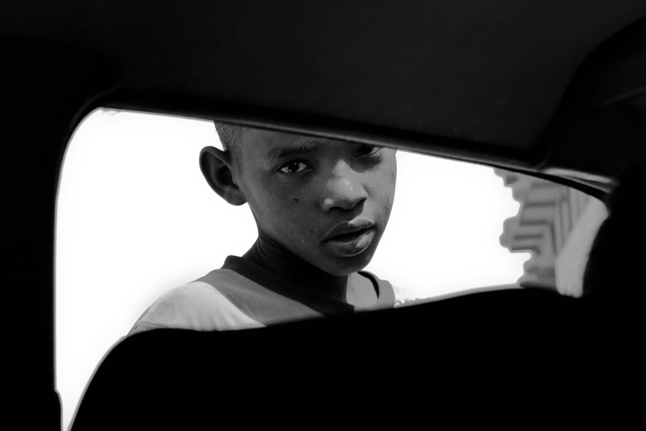 An African portrait using the compositional technique of a frame within a frame.