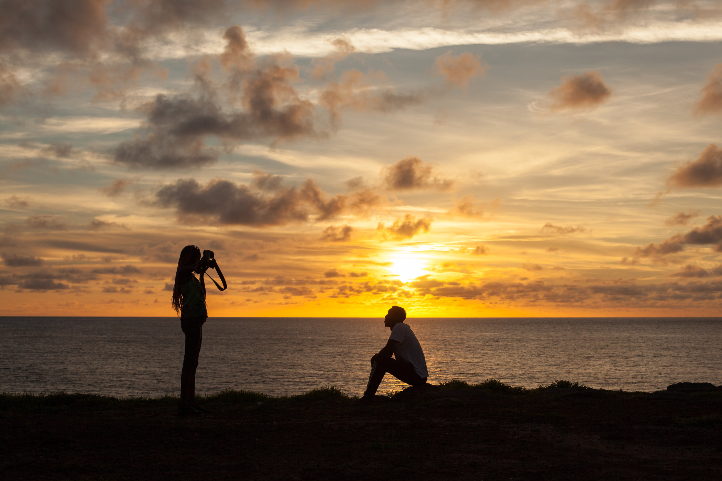 A photo shoot takes place at sunset on Ngor island in Senegal.