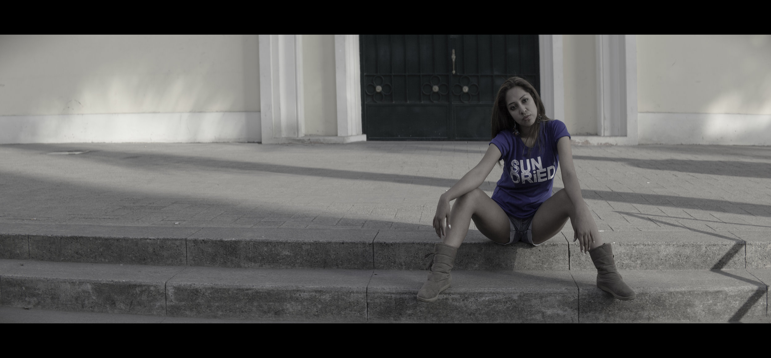 Portrait photography using an anamorphic lens on a DSLR camera.