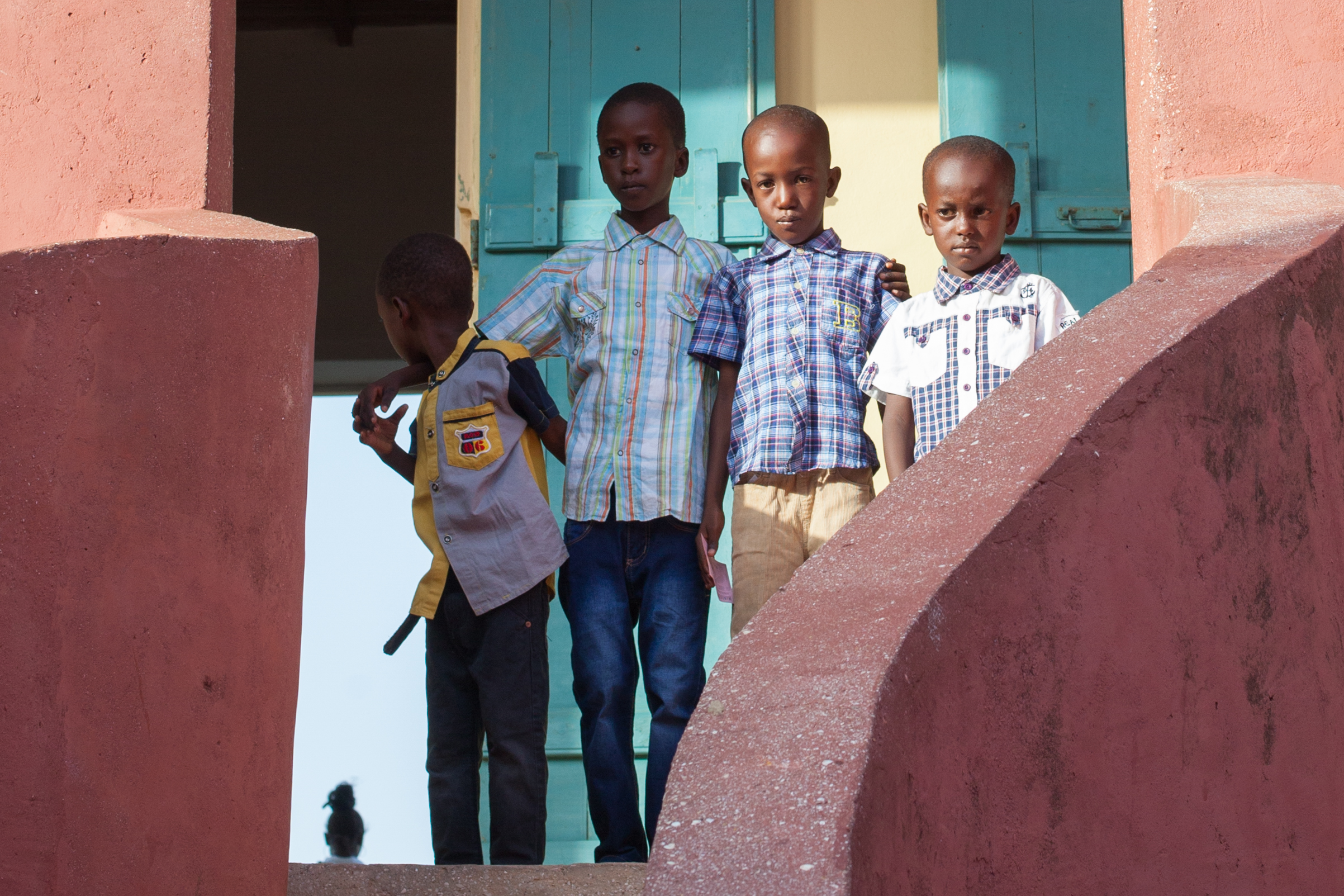 African children stand in front of the slave house on the Island of Gorée, Dakar, Senegal.
