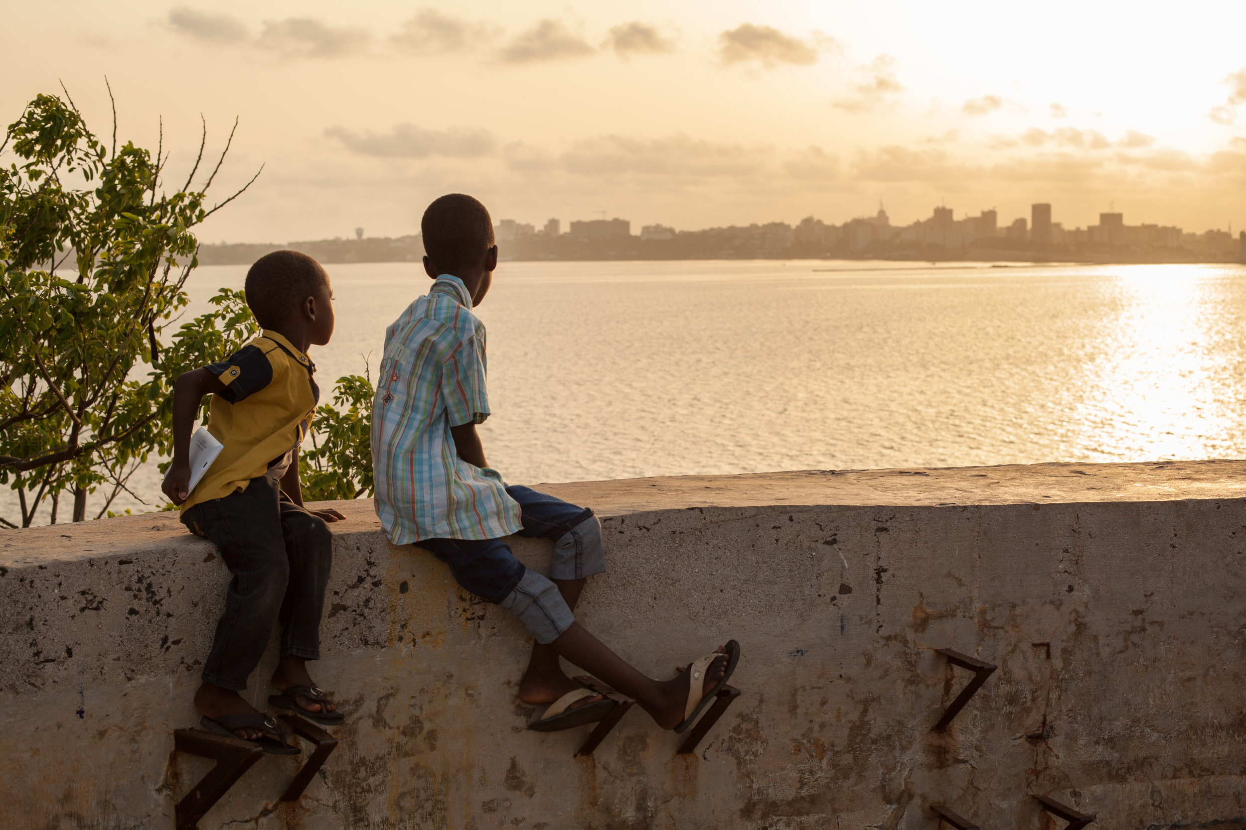 Two African boys at sunset on the Island of Gorée, Dakar, Senegal.