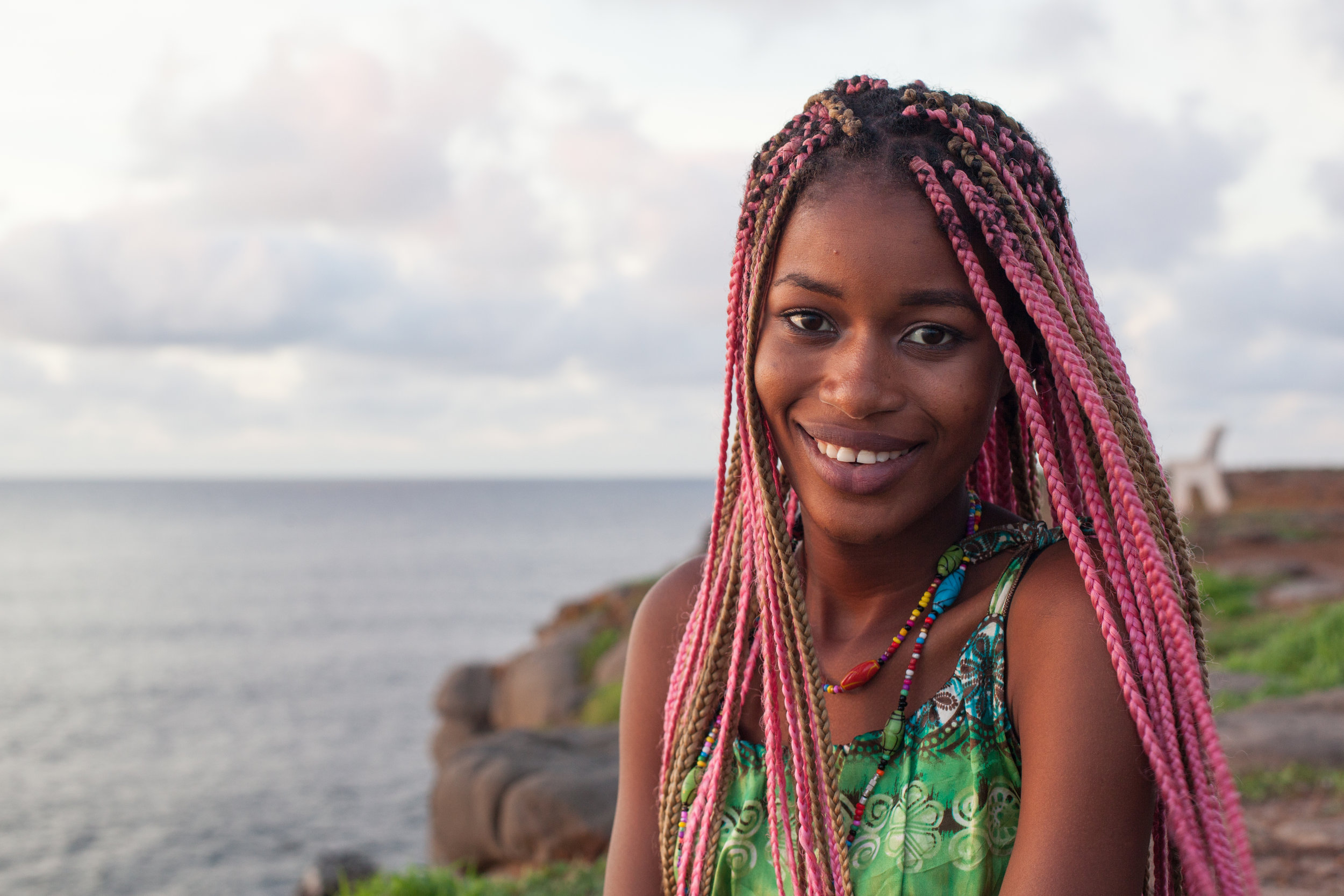 A smiling Senegalese model on the island of Ngor in Dakar.
