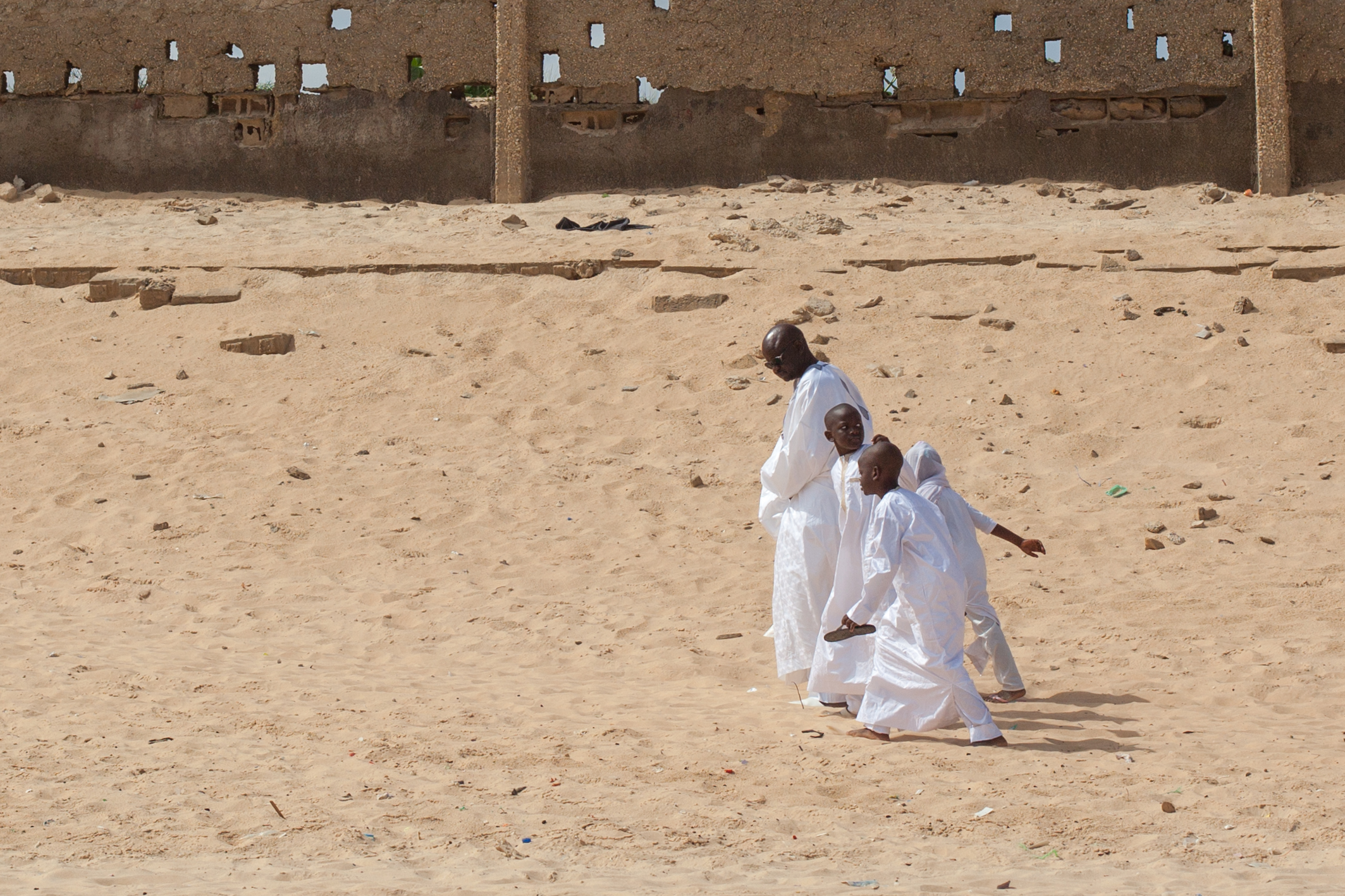 A family returning home after Sunday service at the mosque in Dakar.