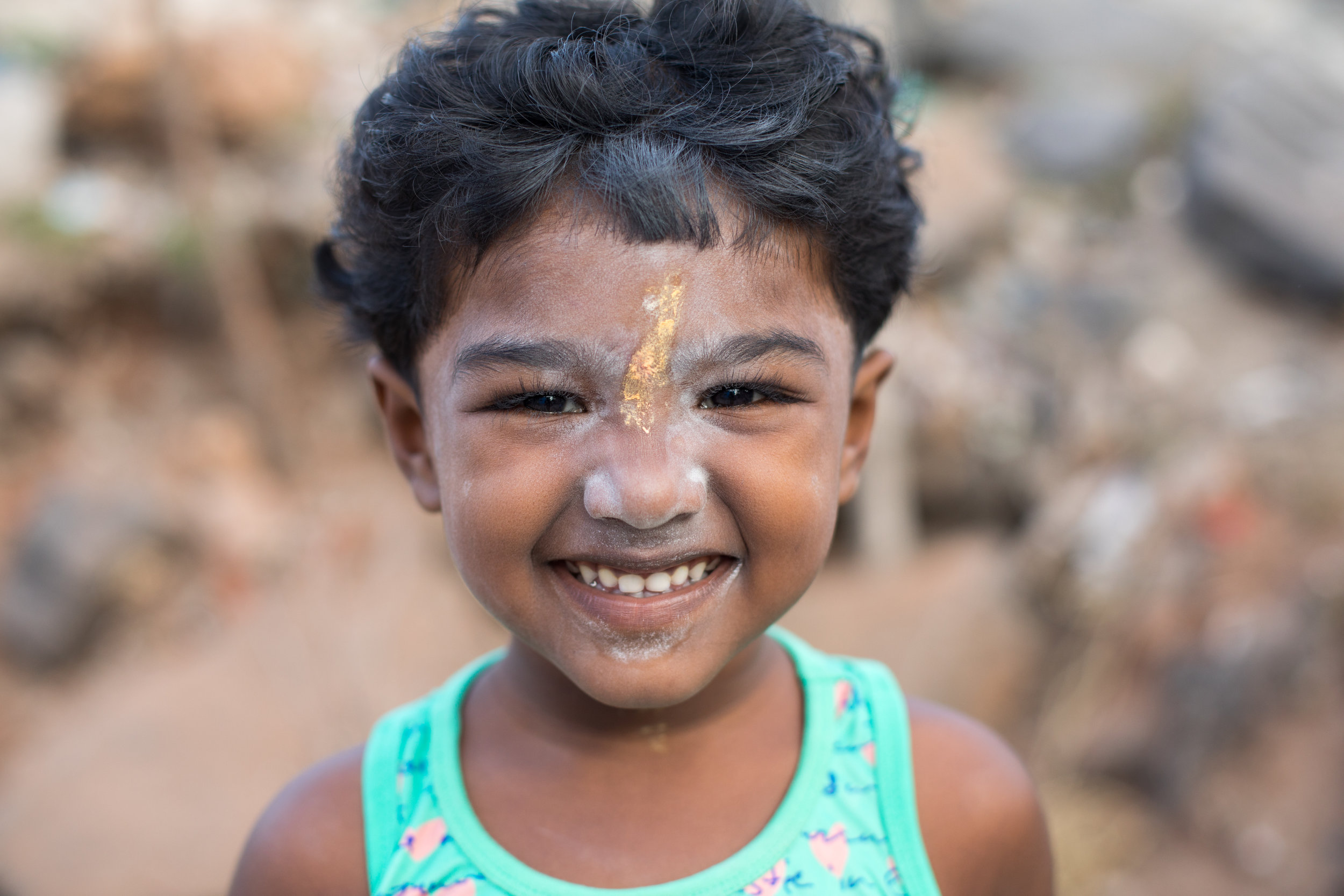 A smiling child on the beach near Pondicherry, an ex French colony in India.