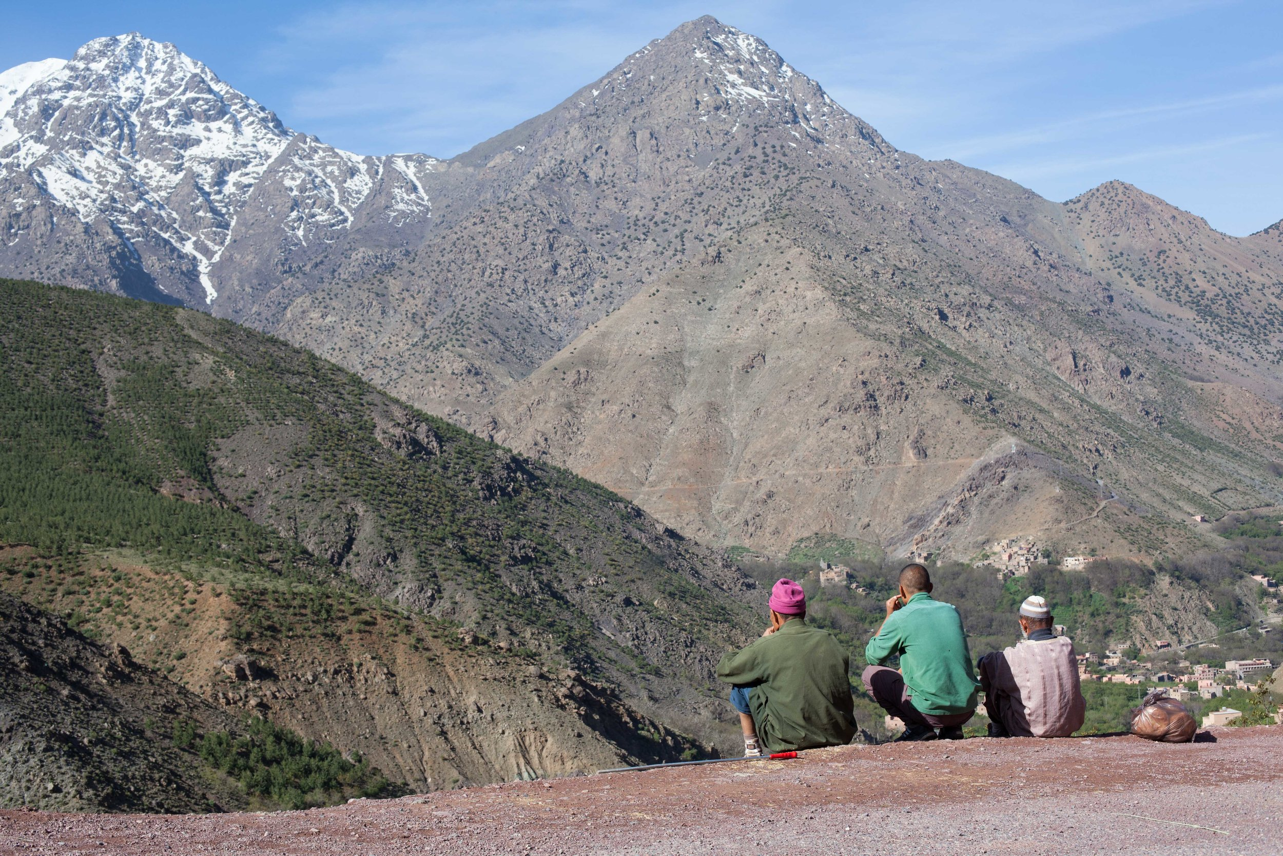 Berbers, are an ethnic group indigenous to North Africa.  Three locals enjoying the view from their backyard in the Atlas Mountains.