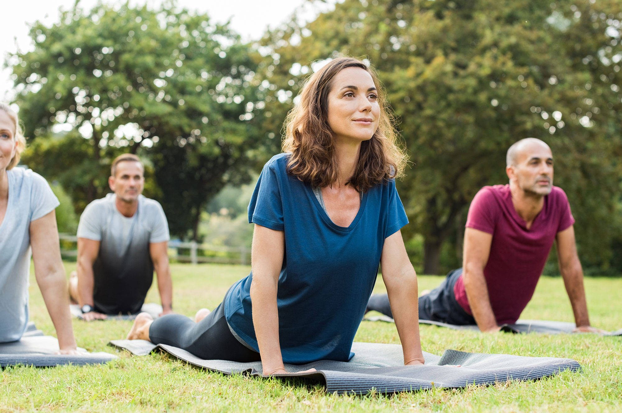 Outdoor Power Yoga class in Boulder's Chautauqua Park. Ditch the yoga studio and discover the FitLiv experience.