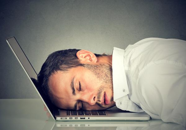 man asleep on computer exhausted.jpg