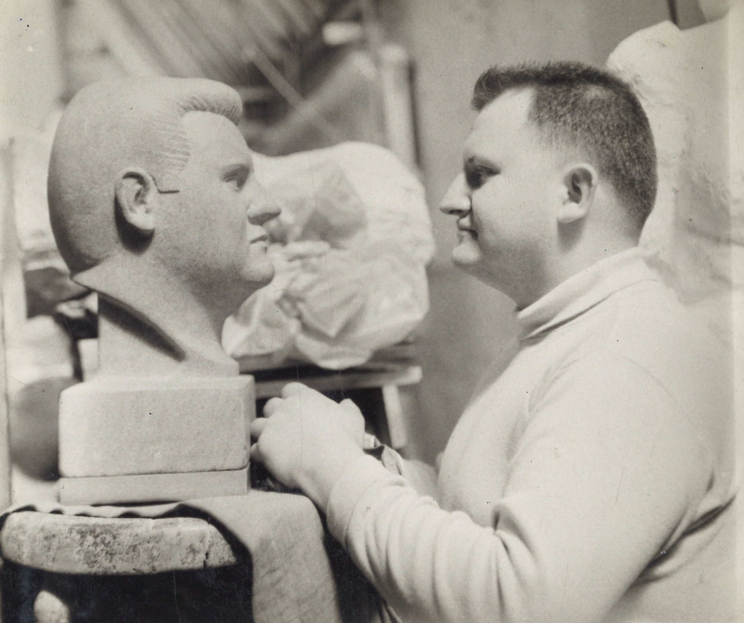 Emil confronts his image in stone carved by fellow ASL student Atillio Fierro (Photo by Atillio Fierro).