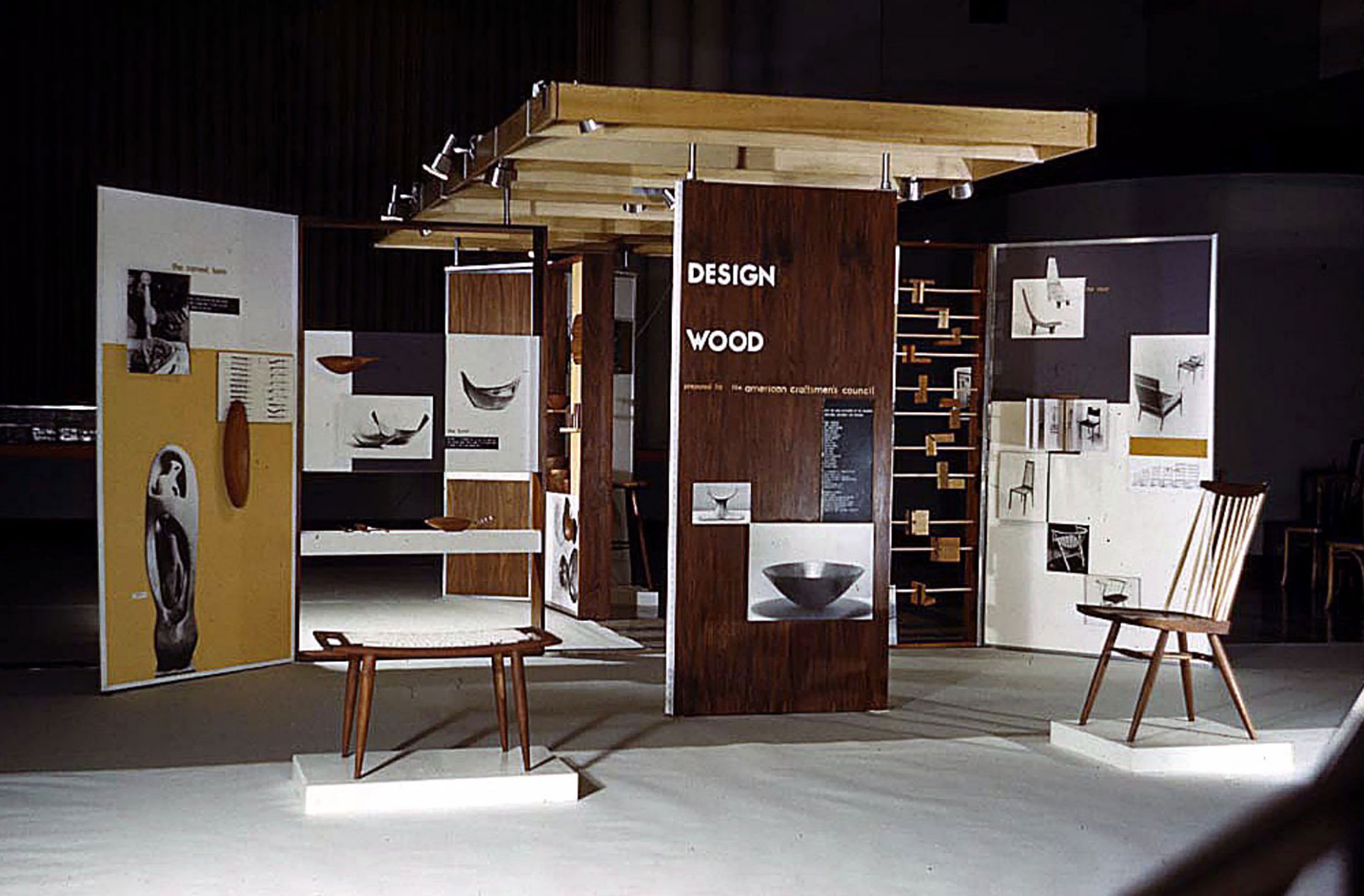 The 1957  Design Wood  exhibit was conceived as an educational outreach program of the ACC. Emil's bowls are visible in the back central table and panel. Courtesy of the American Craft Council.