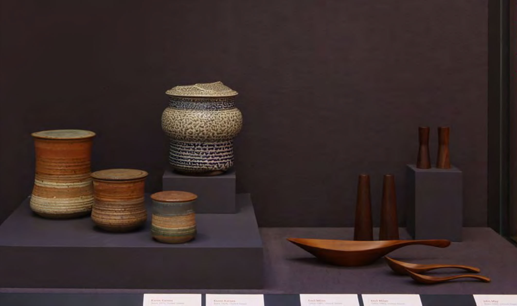Emil MIlan's works (right) on display next to those of legendary potter Karen Karnes (right).Installation image from  Eat Drink Art Design  (September 21, 2010 – March 27, 2011). Courtesy of the Museum of Arts and Design.