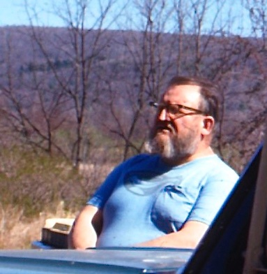 """Emil Milan shown wearing his """"Wood is Warm"""" t-shirt at Peter's Valley, c. 1970s."""