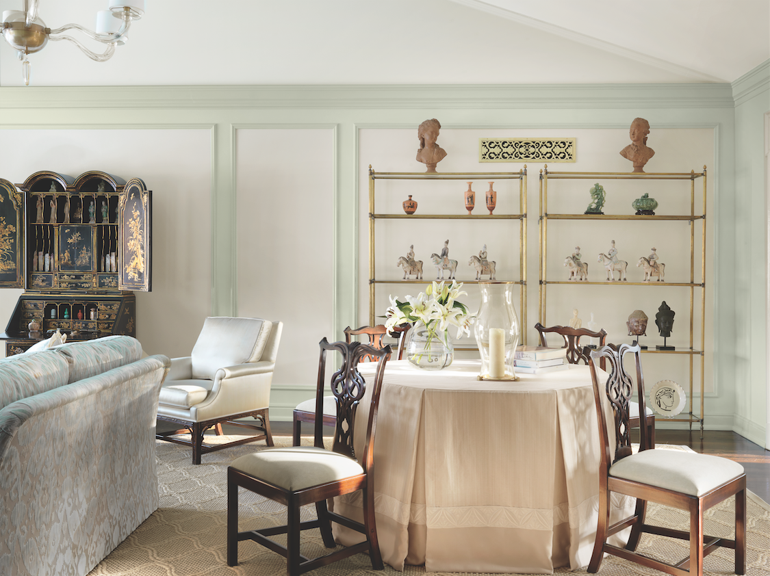 Picture frame molding surrounds the 18th century chinoiserie secretary and a collection of antiquities from around the world.