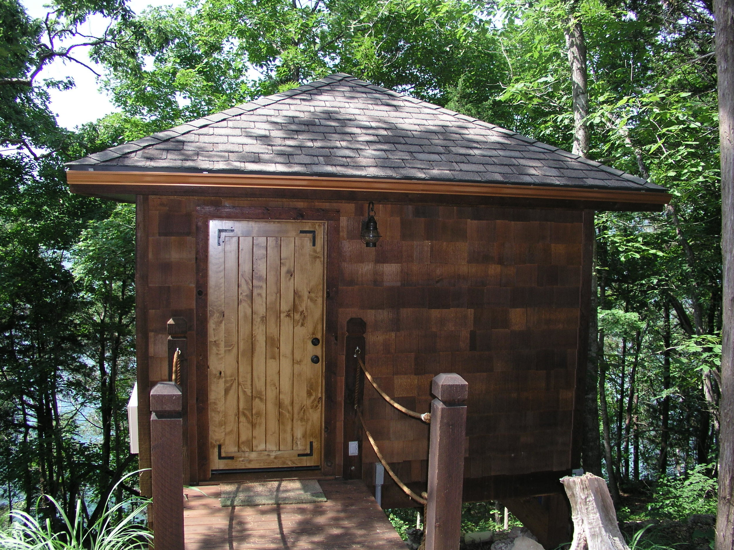The spa services are completed in treehouse suites with windows looking out to the lake.