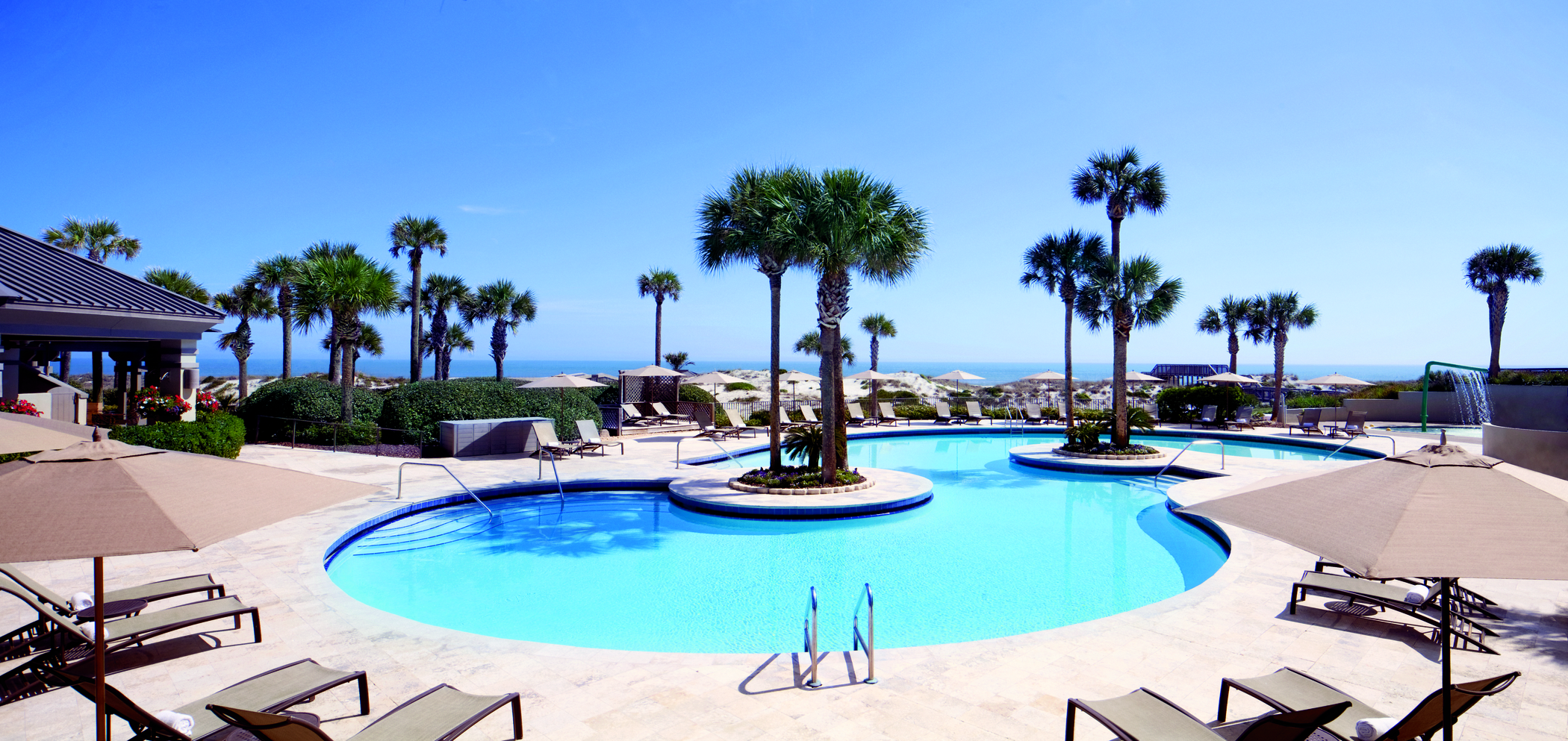 The swimming pool is just steps away from a boardwalk which leads to the Atlantic Ocean and beach activities.