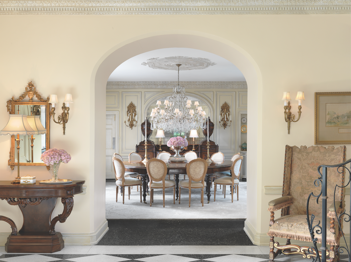 Superbly framed by a deep arched doorway, an antique sideboard and Irish hunt table are the centerpieces of the formal dining room.