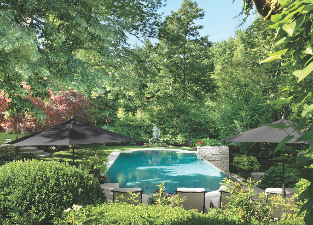 The pool house and infinity-edge pool were added in the homeowner's first remodeling phase, replacing a putting green and sand trap.