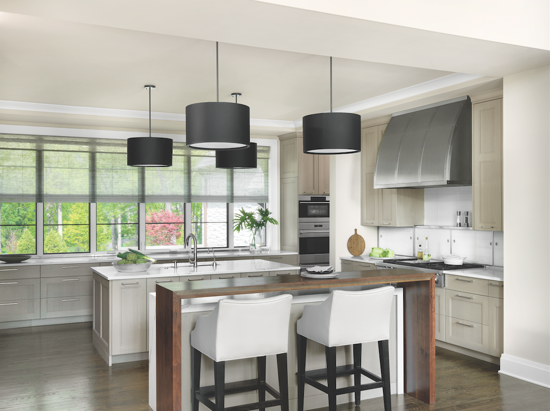 An abundance of deep drawers replaced upper cabinets in the kitchen, permitting abundant light to enter through ceiling-height windows.