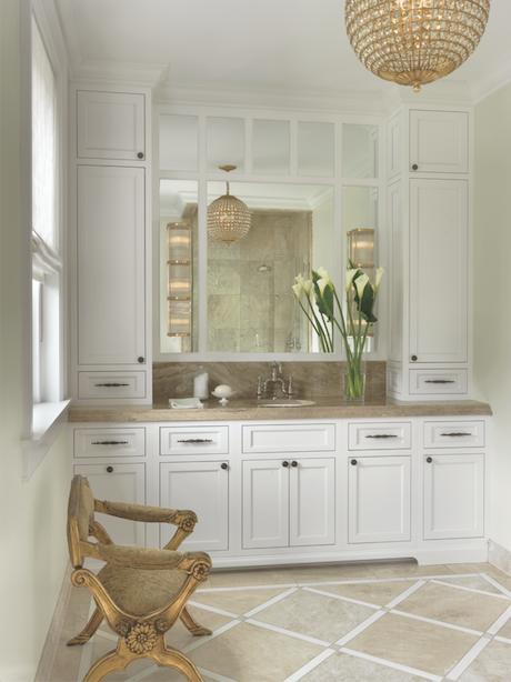 "Gorgeous lighting, a rainhead shower and an abundance of custom cabinetry make ""her"" master bath a luxurious retreat."