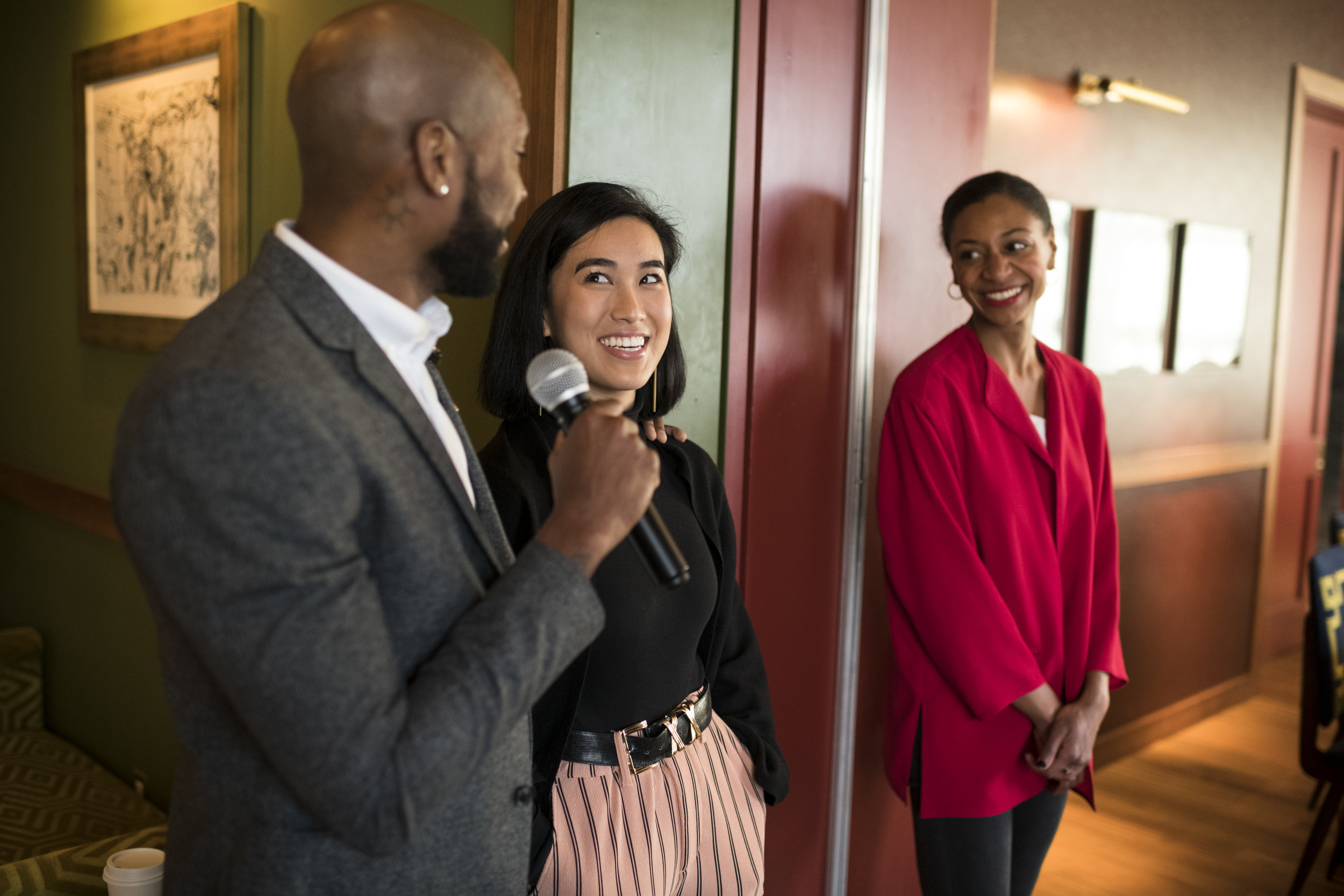 COCA alumni Karina Encarnación (center) and Lauren Morrow (right) talk with COCA Co-Artistic Director of Dance and alumnus Antonio Douthit-Boyd during brunch at Legacy Records in Hudson Yards. Photo by Jacob Blickenstaff.
