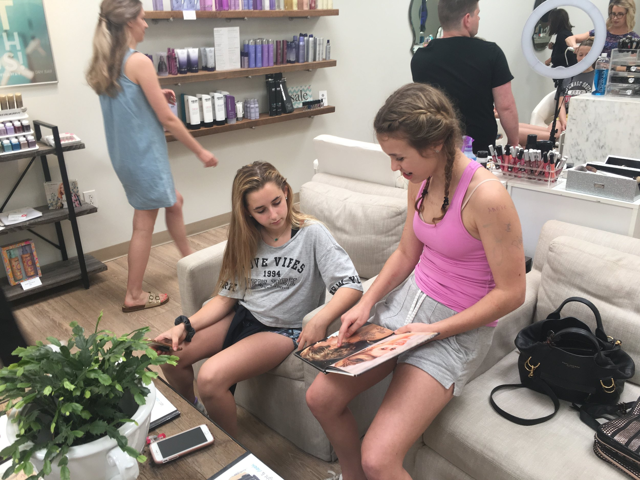 "Campers flip through a ""look book"" for inspiration."