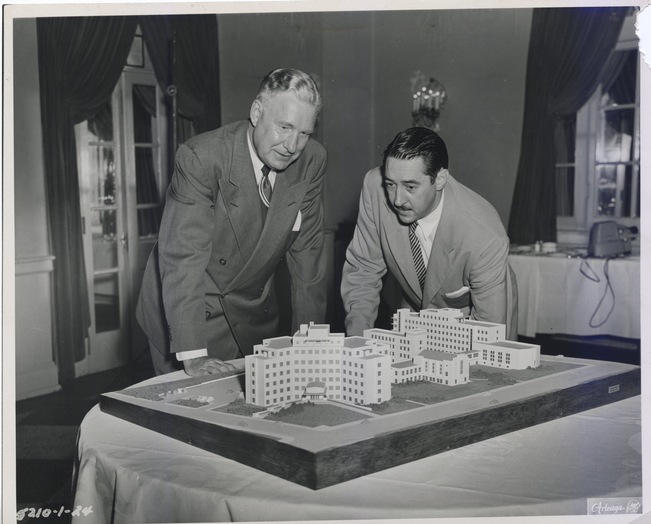 From the left, Leo Wieck and Dr. Peter Danis, two of the founders of the first Catholic Children's Hospital in St. Louis, look at the tabletop model. The model was taken to each fundraising event. Photo provided by SSM Health Cardinal Glennon Children's Foundation.