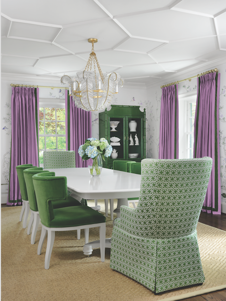 Beneath a beautifully crafted ceiling, the formal dining room becomes fun and fabulous with a bold color combination.