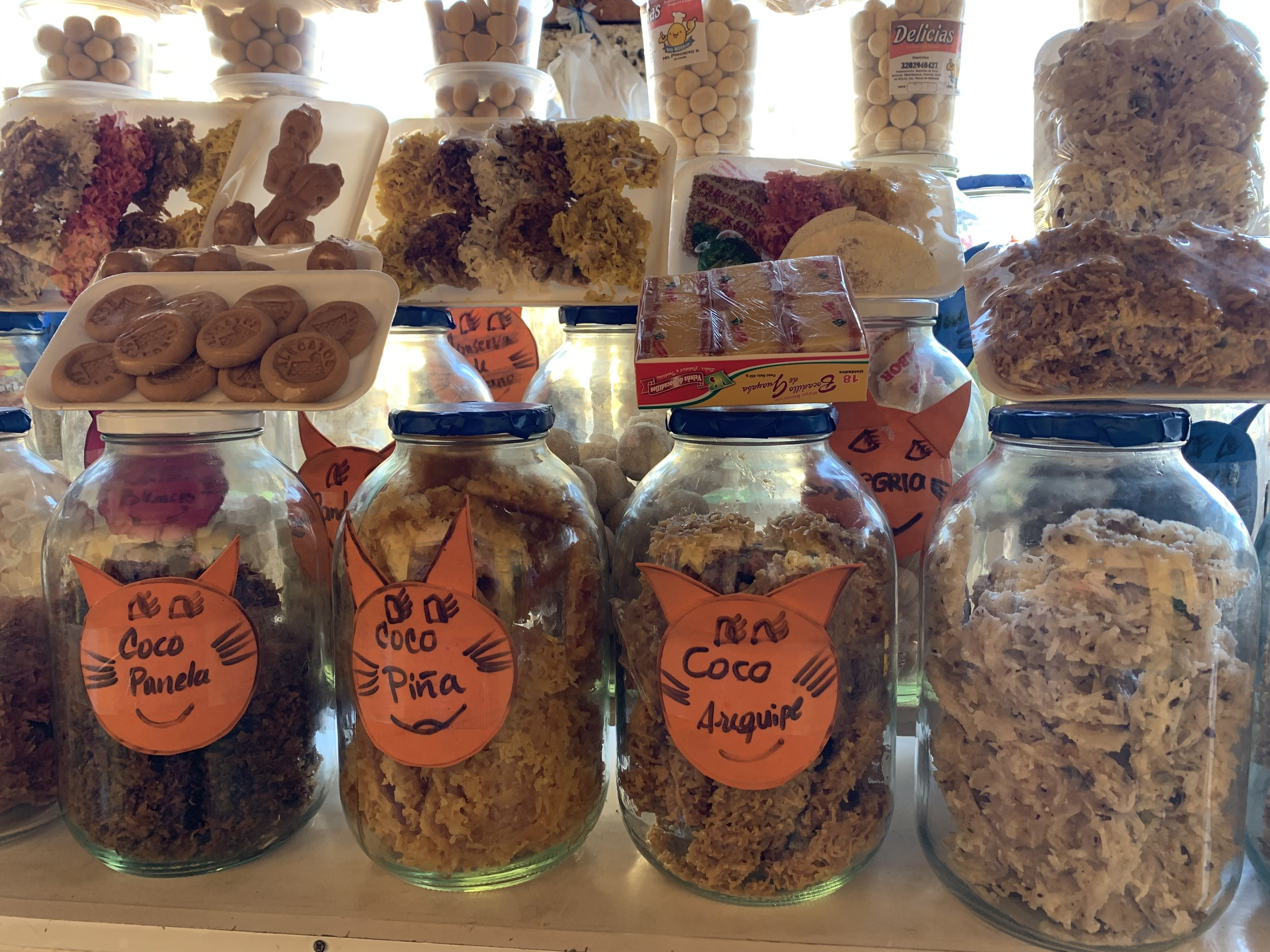 A sampling of homemade dried and sugared fruits in different flavors, on sale in the marketplace near La Torre del Reloj (Clock Tower Gate).