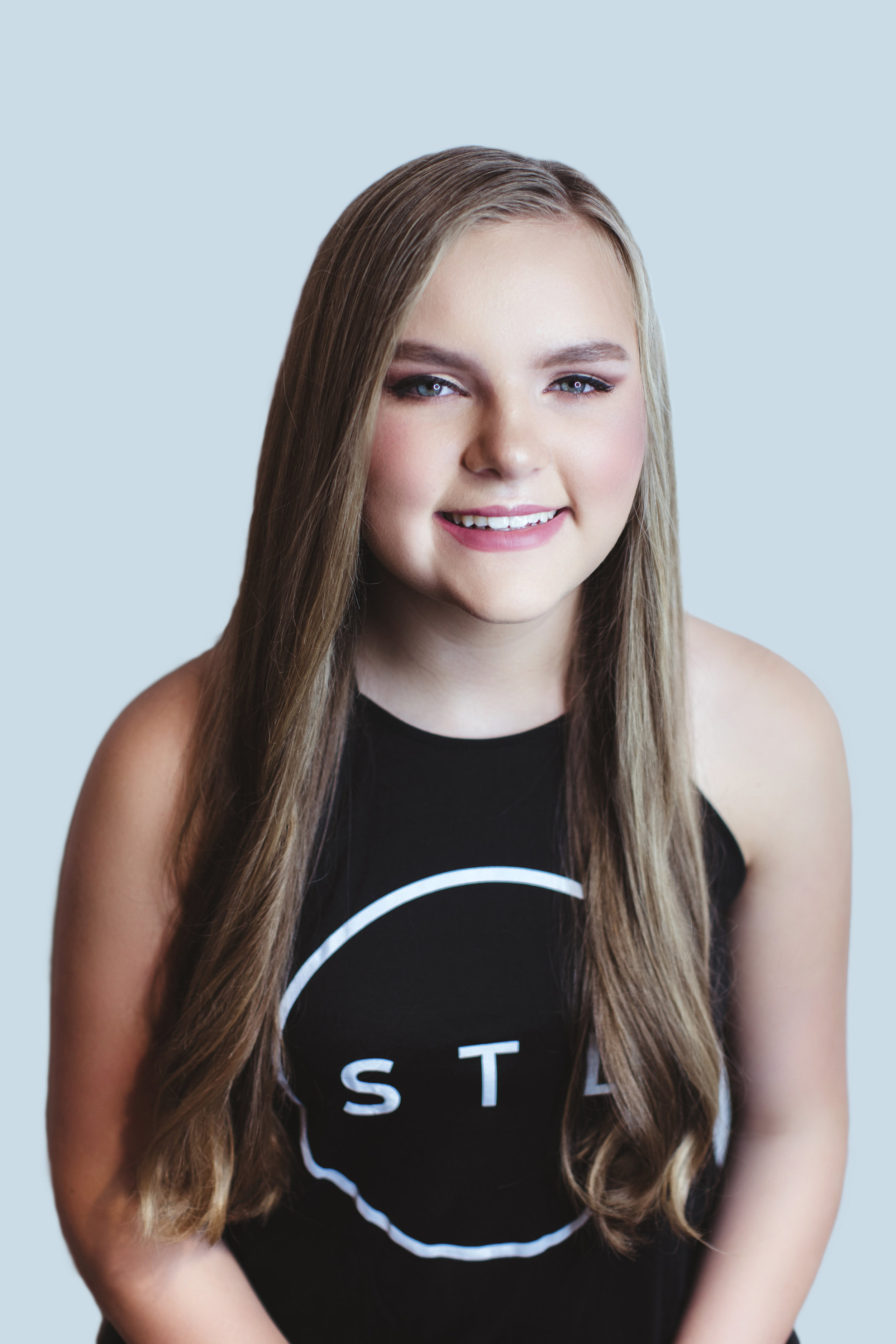 Olivia, a freshman at Villa Duchesne, chose a simple blown out look, a sophisticated style accentuating her beautiful, long hair which Dominic says is most popular right now.  Makeup By Rose Turner  Hair By Dani Stassi