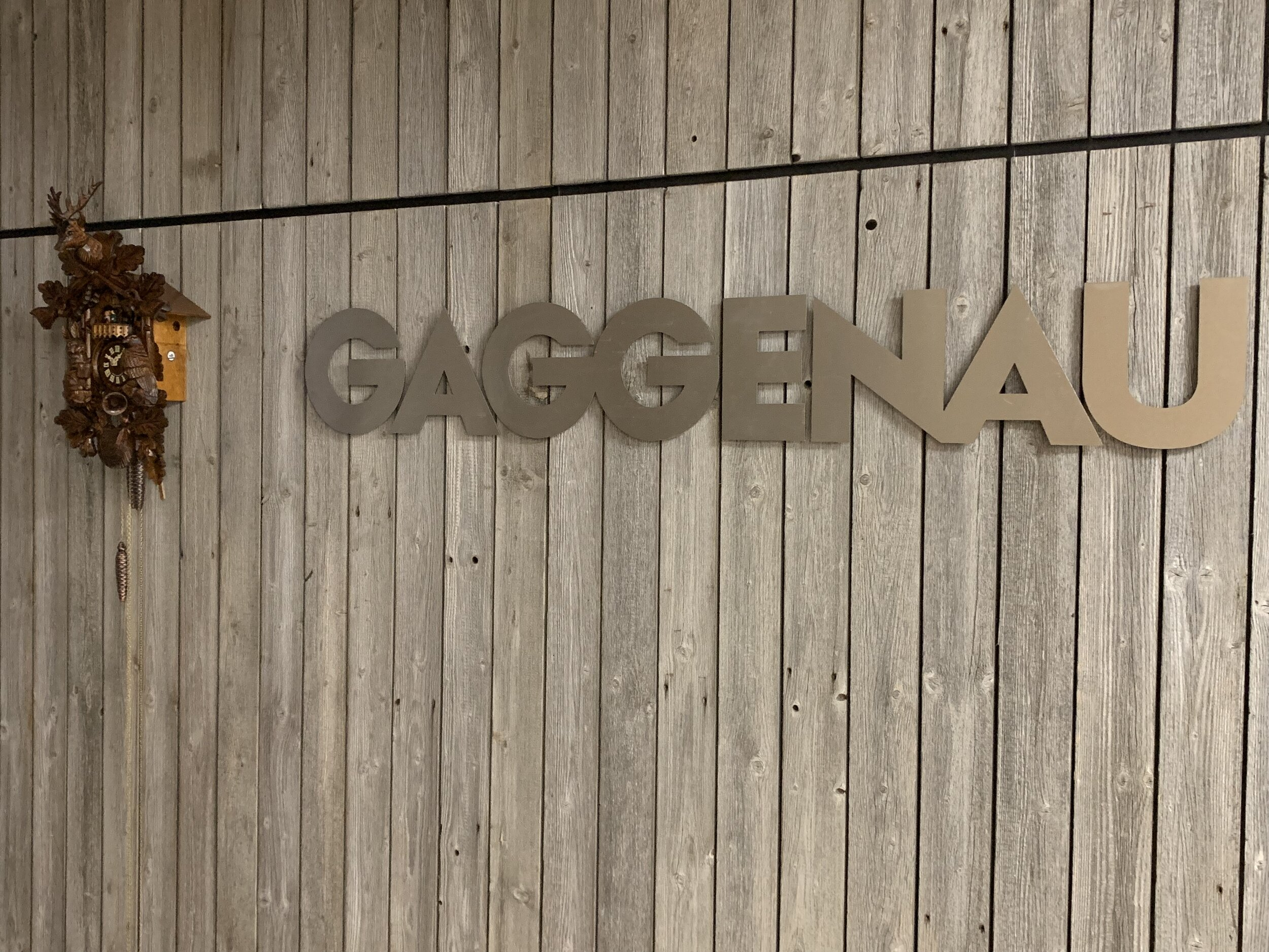 A cuckoo clock is hung next to the recognizable sign of Gaggenau, inside the devoted showroom at AUTCOhome in Fenton.