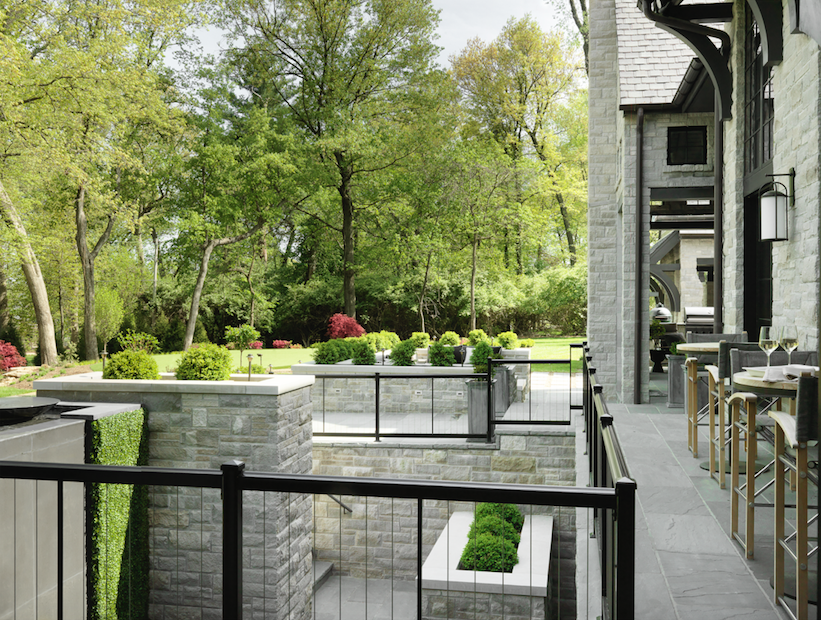 An expansive deck outside the main living area overlooks a waterfall and gorgeous landscaping.