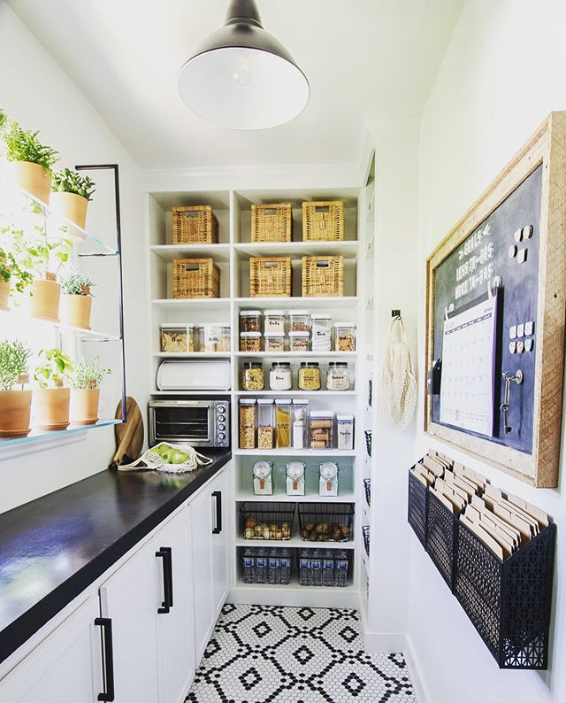 Sunday Eye Candy: While browsing Pinterest and sipping my coffee this morning I stumbled upon this beauty! @simplicityinthesouth knocked it out of the park with this walk-in pantry. The floor, soapstone, command center, plant shelves, labels... I could go on and on! So much goodness in a small space. 👏👏👏 Now I'm trying to squeeze those shelves in our hardworking mud room. They're available in their Etsy shop, too!  #sundayinspiration #pantry #soapstone #commandcenter #simplicityinthesouth #patternedfloor #herbwindow