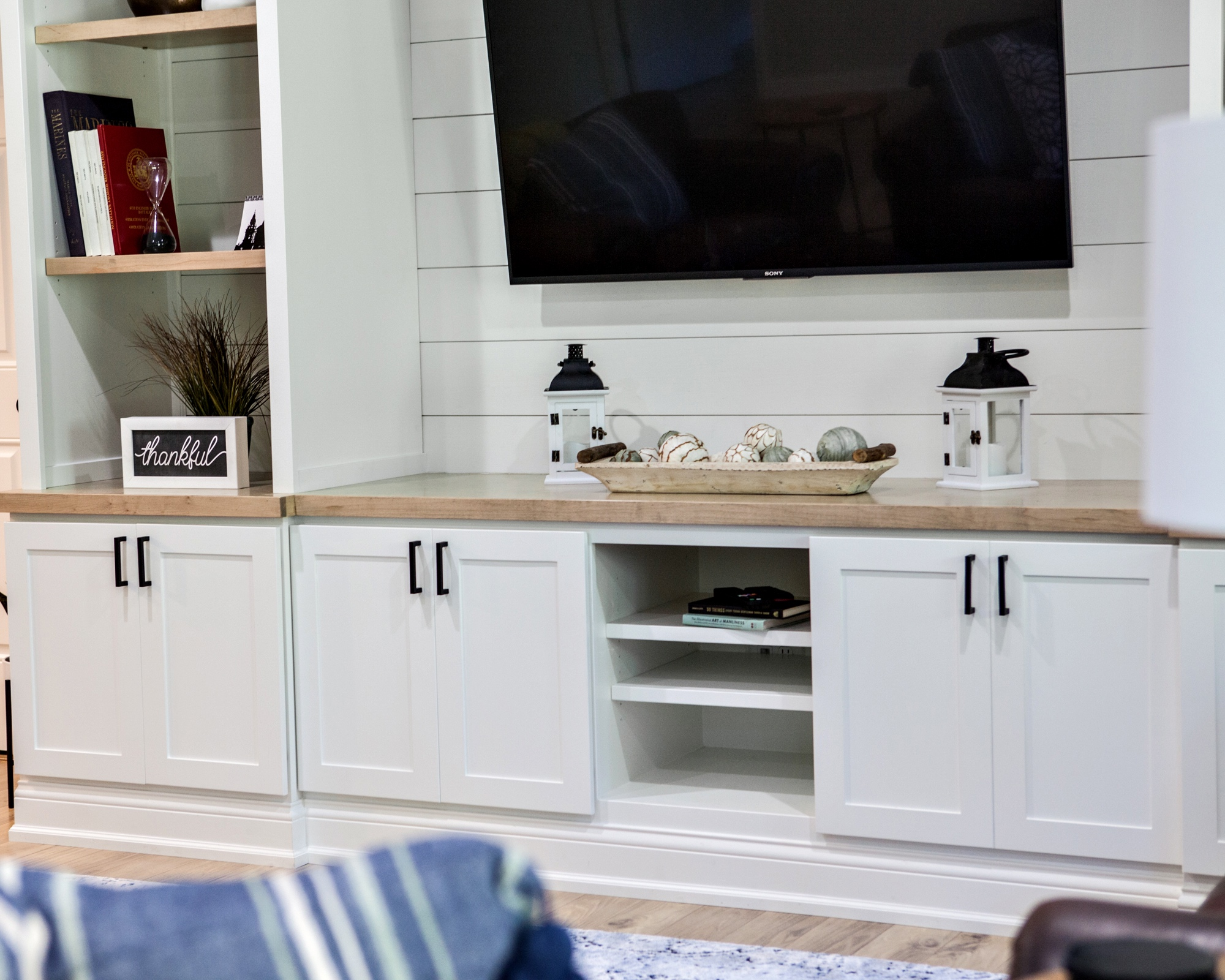 CUSTOM CABINETRY - From kitchen cabinets & bathroom vanities to living room built-ins, we work with carpenters to design functional pieces to fit your style.