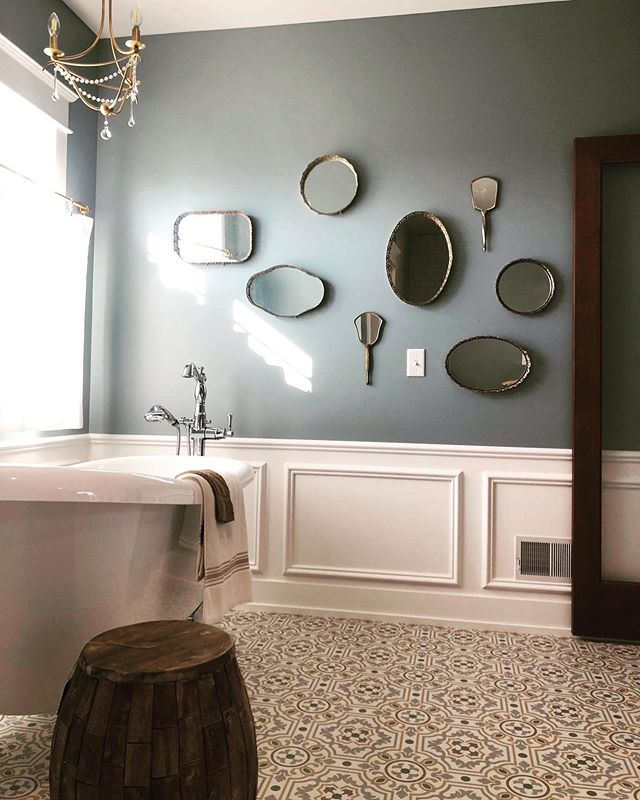 Adding sentiments to this beautiful remodeled farmhouse has been so exciting to see. We took the client's grandmother's hand mirror and added other vintage mirrors & trays to this wall to create a one of a kind gallery that tells a story. #farmhouseremodel #accessorize #grandrapids #grandrapidsmi #vintagemirrors #antiquemirrors #grandrapidsinteriordesign #grandrapidsinteriordeaigner #soakertub #oldandnew #weatheredwood