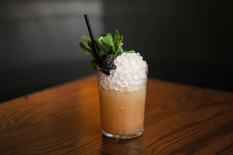 The Sherry Cobbler with sherry, homemade orgeat, bitters and fresh berries.PHOTO:ANDREW KIST