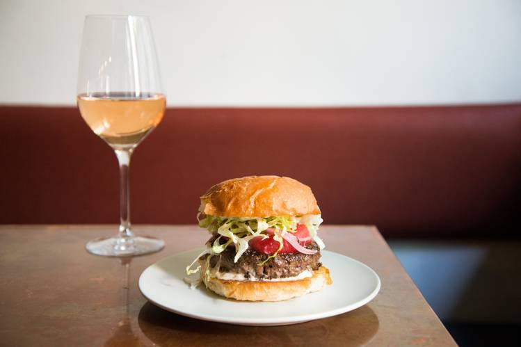 At King Bee, the Hour of Good Cheer special pairs a signature burger and a glass of bubbly rosé for $20.PHOTO:KATIE BURTON