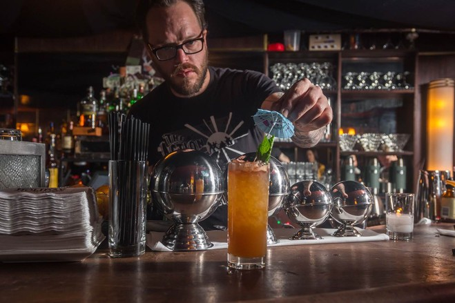 Danny Neff, bar manager at Holiday Cocktail Lounge, puts the finishing touches on a drink.PHOTO: PAUL WAGTOUICZ