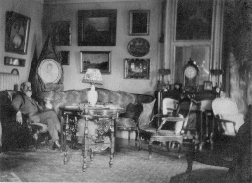 Family photograph showing Viktor Goriany in his Paris apartment with the present watercolor on the wall