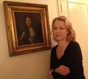 Margaret Dalivalle with a framed painting