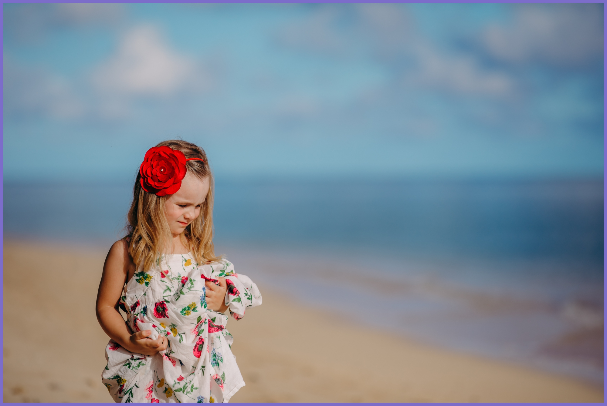 Girl with flower on the beach - Oahu children photographer - Ketino Photography.jpg