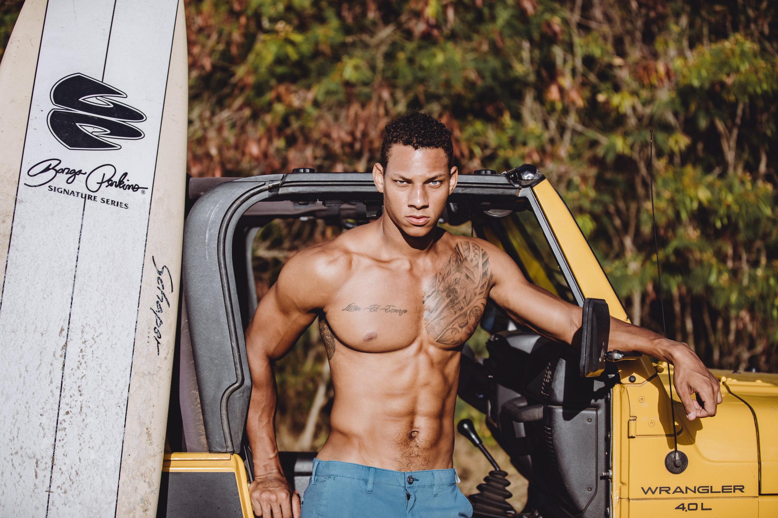 Premier model agency honolulu - jacob - fitness model with surf board - waimanalo beach hawaii fitness photographer.jpg