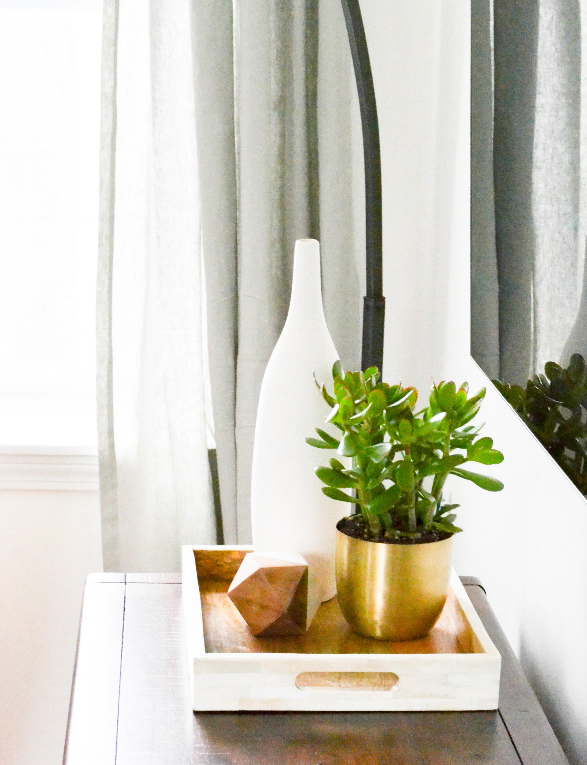 Gray Oak Studio Pearl Street living room brass planter