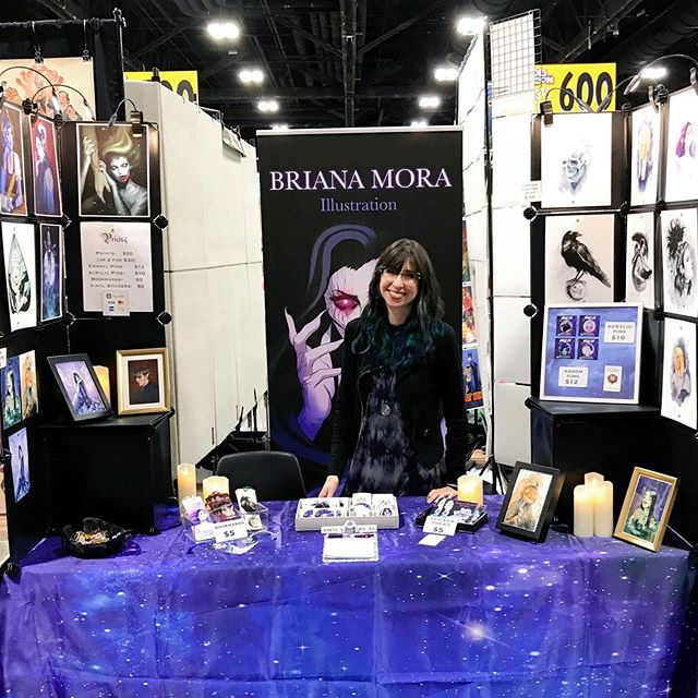 All set up at #heroescon !! I'm so looking forward to seeing old friends and making a few new ones. Come through and see me at booth AA-622!! #criticalrolefanart #elfprince #heroescon2019 #hollyblack #thewickedking #criticalrole #labyrinth #jareth #goblinking #critters #odinsravens #ravens #thecruelprince #mermaid #swampwitch #witchyart #pingame #bookishlife #dungeonsanddragons #dnd #adsom