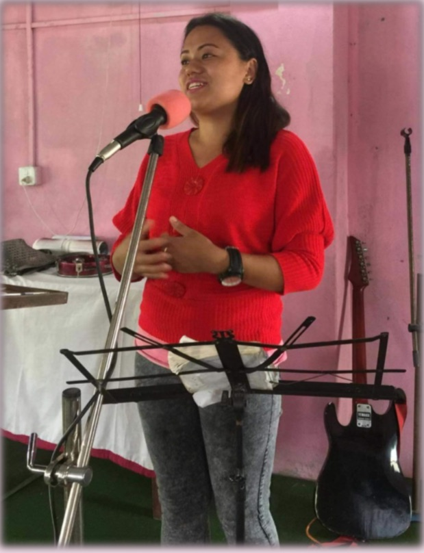 Sangenma giving her testimony in a mass