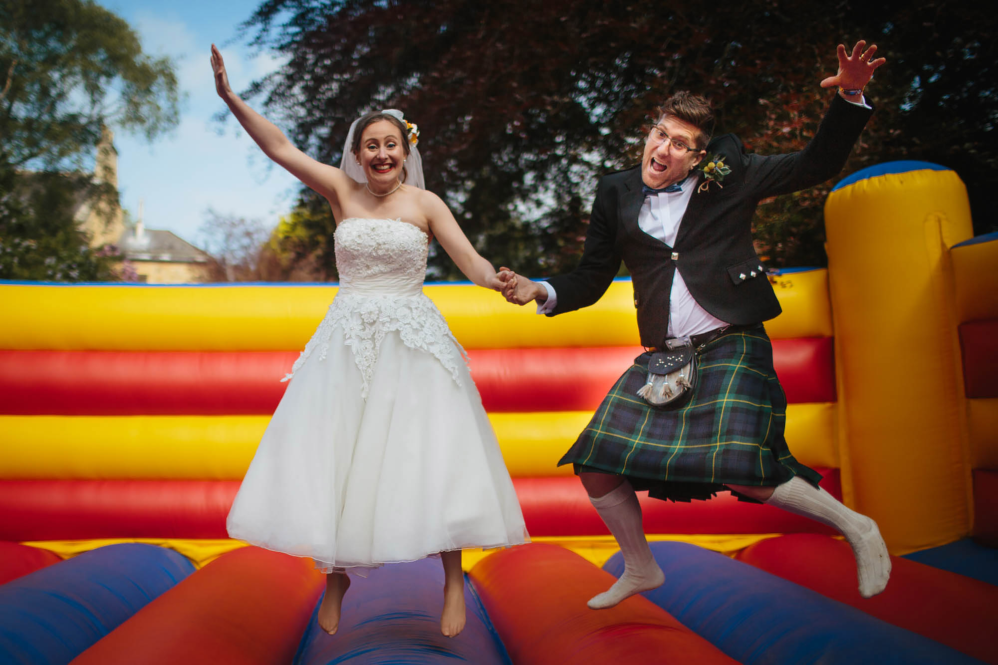 Leeds Yorkshire Wedding Photographer Bouncy Castle Jump
